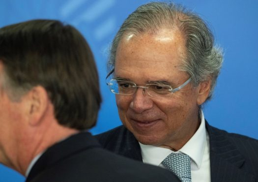 President of Brazil Jair Bolsonaro (L) and the Brazilian Economy Minister Paulo Guedes (R) take part in the signing ceremony of the Legal Taxpayer's Provisional Measure.